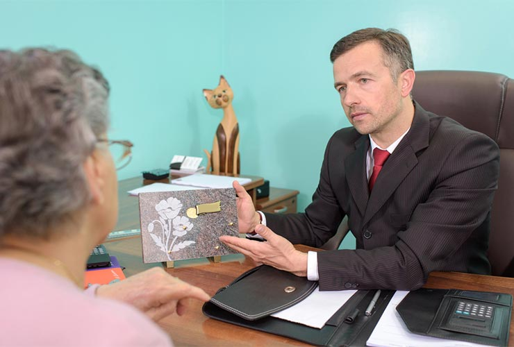 Funeral director with client